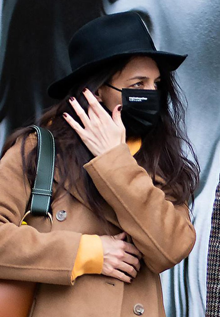 Katie Holmes keeps a low profile with a black fedora hat and a face mask