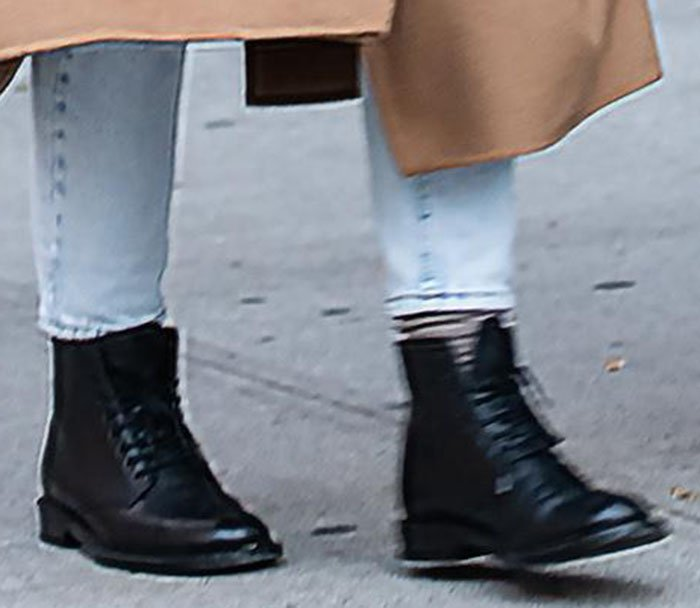 Katie Holmes completes her chic fall look with lace-up leather ankle boots