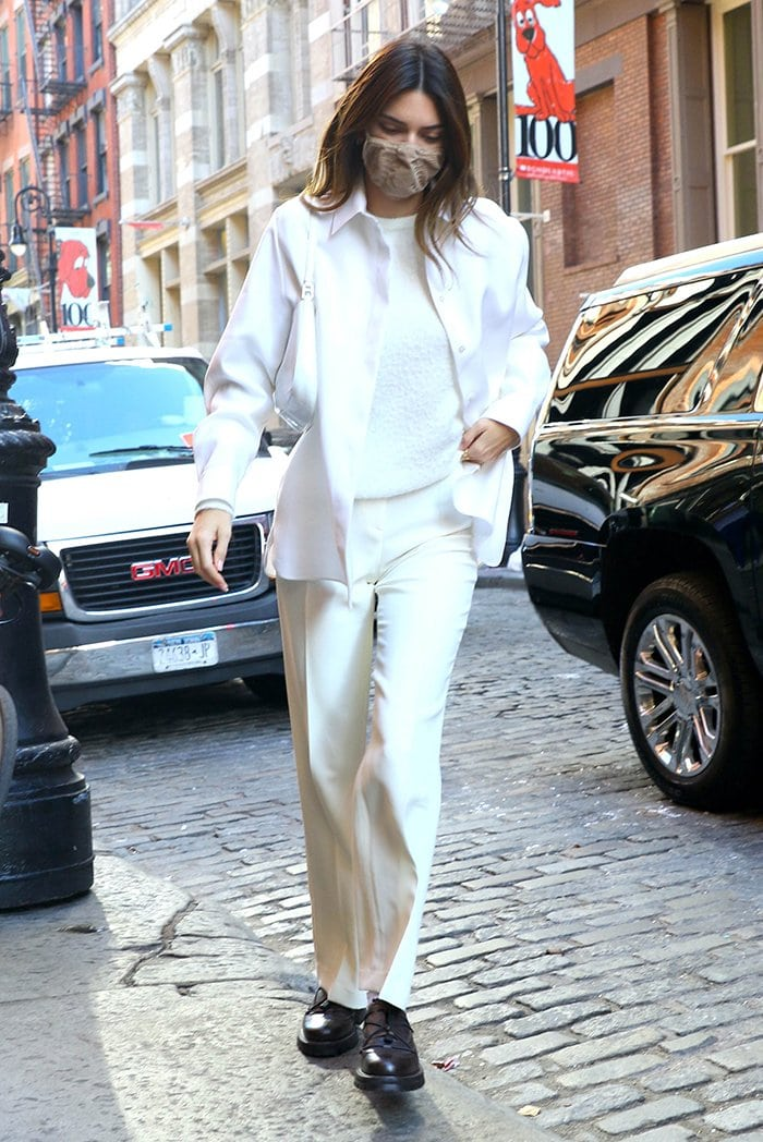 Kendall Jenner looks runway ready in white textured blouse, shirt, and Musier Paris pants