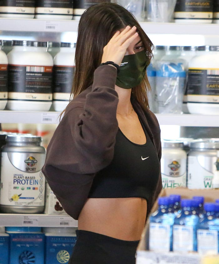 Kendall Jenner shows off her flat abs in Nike sports bra and leggings