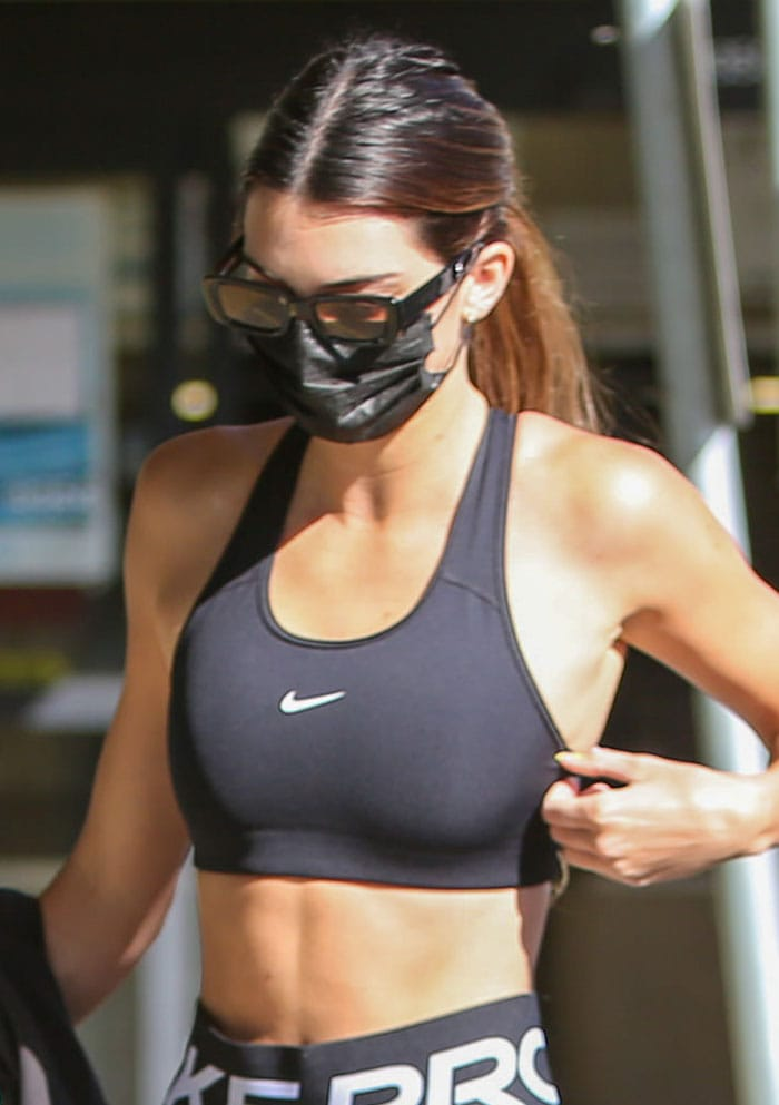 Kendall Jenner keeps it low key with Dmy sunglasses and a black face mask