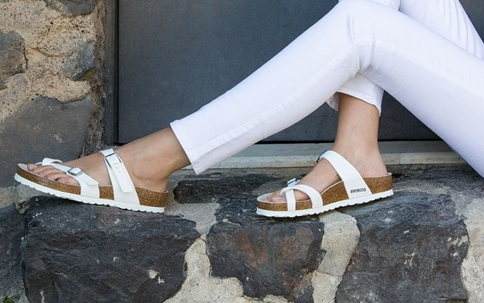 These bright white Mayari triple-strap sandals are the perfect complement to any outfit