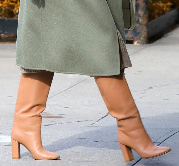Olivia Palermo completes her fashionable voting look with Casadei knee-high boots