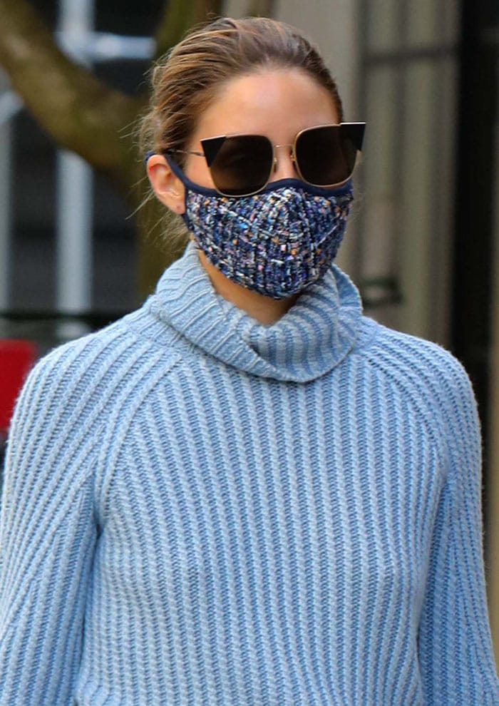 Olivia Palermo styles her look with a blue tweed face mask and Fendi cat-eye sunglasses