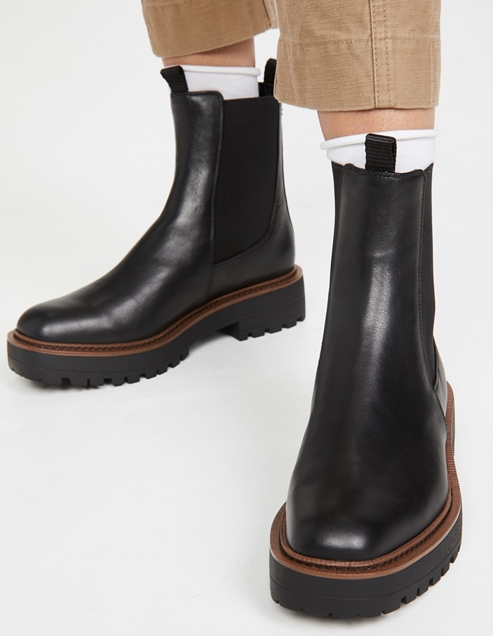 Waterproof black ankle boots are worn with brushed cotton pants