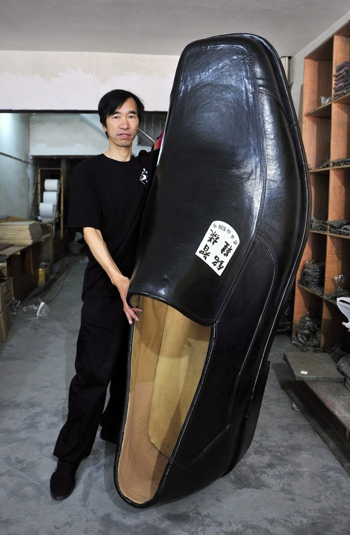 Shoe designer Chen Mingzhi makes shoes in a wide variety of sizes to cater for every eventuality and has created both oversized and pocket-sized shoes