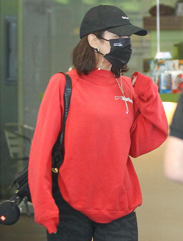 Vanessa Hudgens keeps things low-key in a Realisation cap and black face mask