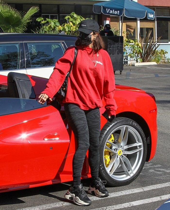 Vanessa Hudgens wears a Tultex Marlboro sweatshirt and a pair of Gymshark leggings