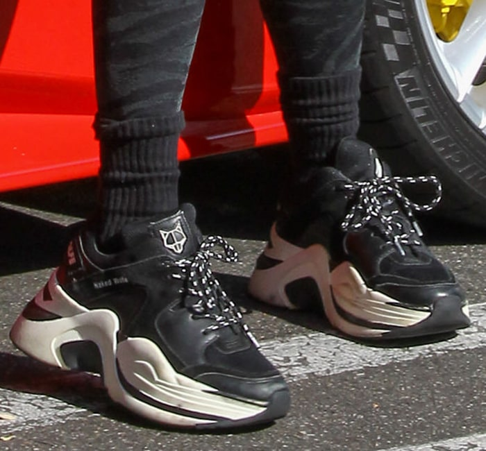 Vanessa Hudgens drives her Ferrari in Naked Wolfe chunky sneakers
