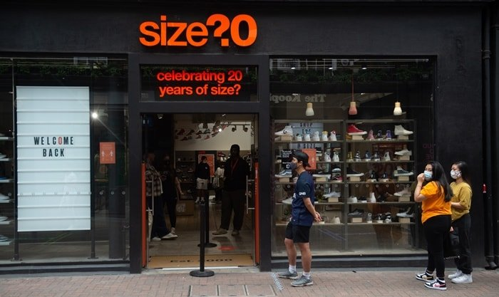 People queueing up outside of the Size? shoe store in Carnaby Street, London, England
