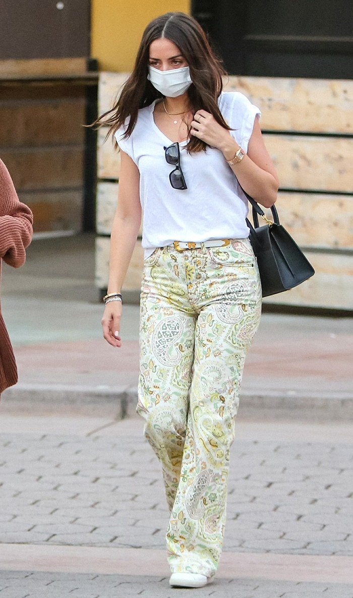 Ana de Armas teams her multicolored paisley jeans with a plain white Current/Elliott tee