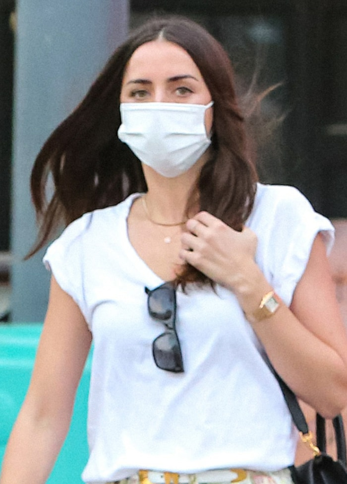 Ana de Armas wears her hair loose and stays protected with a Wakamono face mask
