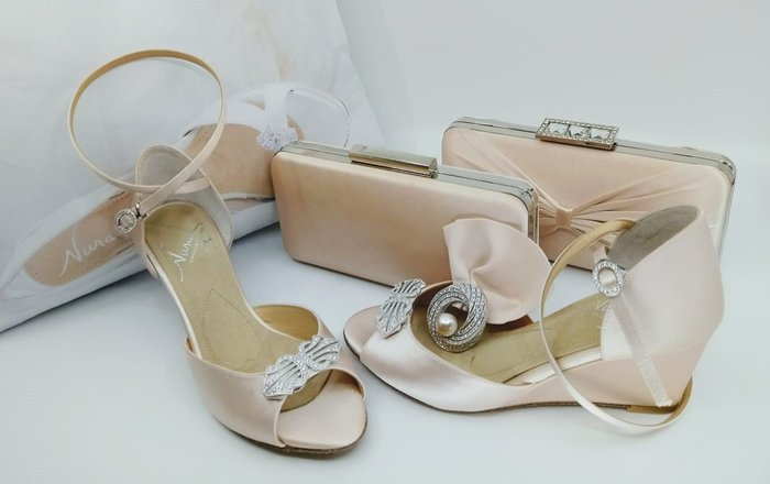Angela Nuran had these wedges and clutches dyed to complement the bride's blush wedding gown