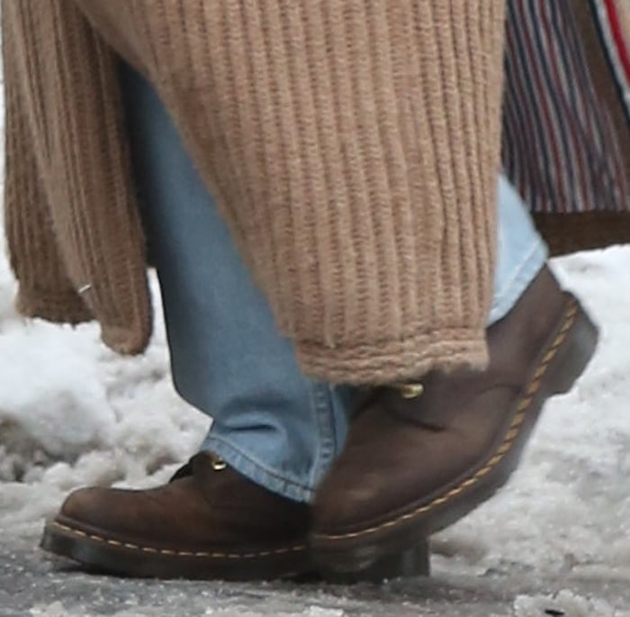Gigi Hadid completes her chic winter look with a pair of Dr. Martens 1460 brown boots