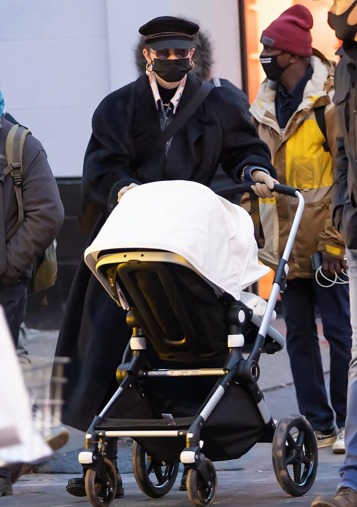 Gigi Hadid bundles up in a shearling coat on a stroll with her baby girl