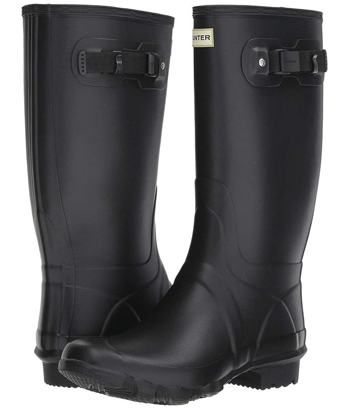 Performance rain boot with a reinforced panel to increase structure and support