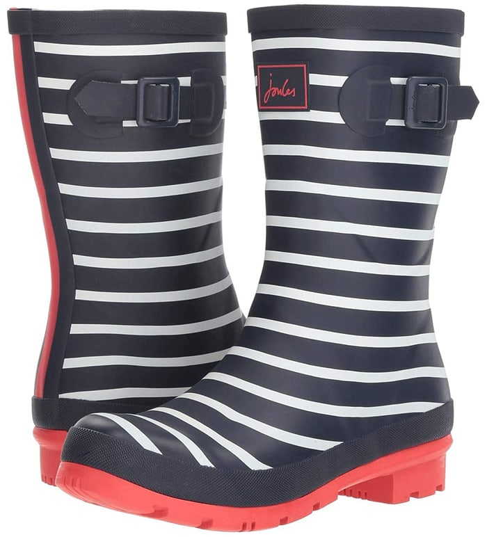 The Joules Molly Welly rain boot will add some fun to your rainy day look with a hard wearing, natural rubber upper, easy pull-on styling, a fun exterior print, and waterproof construction