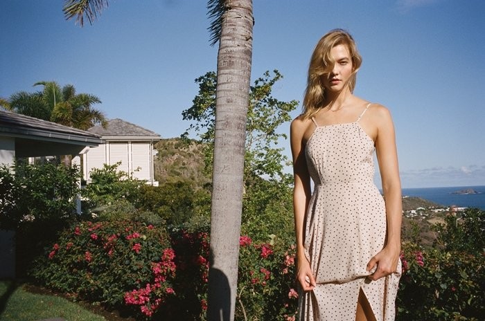 Karlie Kloss promoting her affordable fashion collection with Express