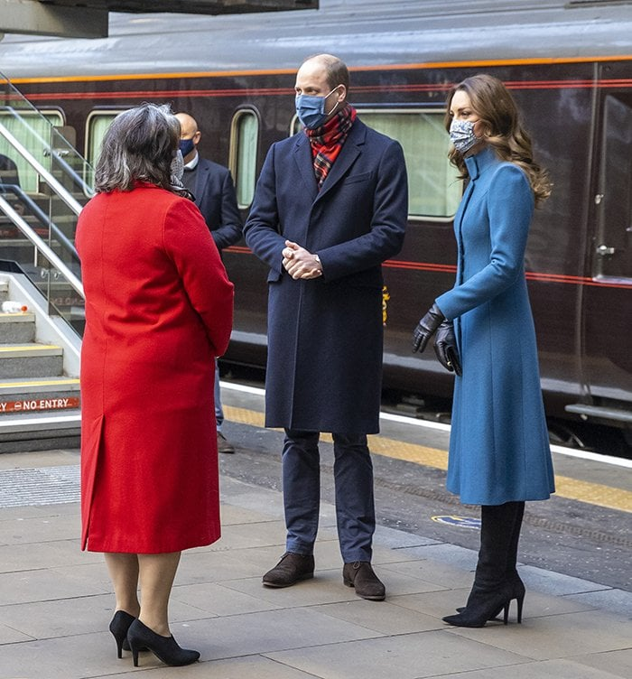 Prince William and Kate Middleton meet the Deputy Lord Lieutenant Sandra Cumming as they arrive by train at Edinburgh Waverley Station on December 7, 2020