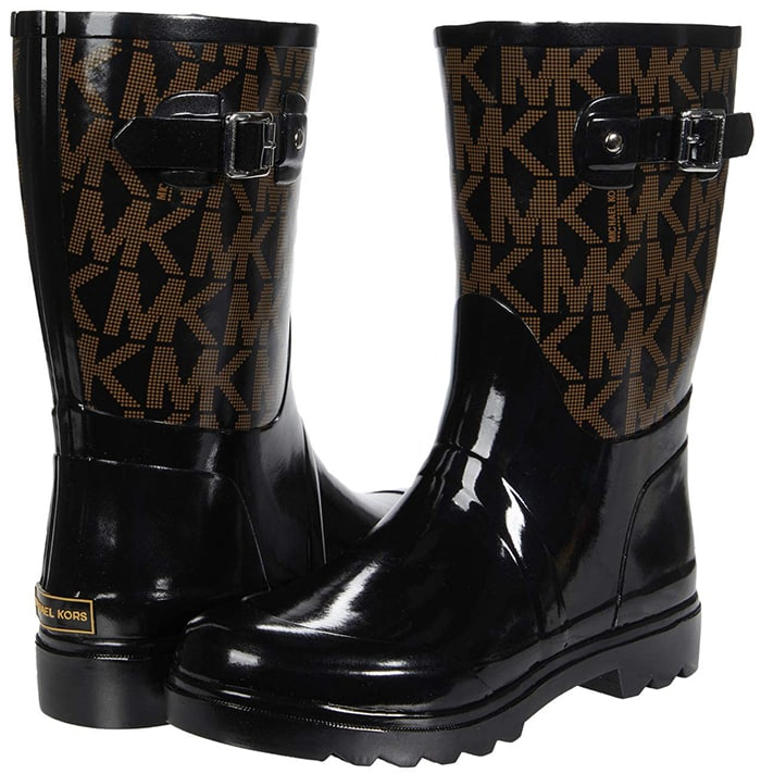 The pull-on rain boots are constructed from a rubberized synthetic upper in a high-shine finish and signature MK logo throughout the shaft for timeless wear