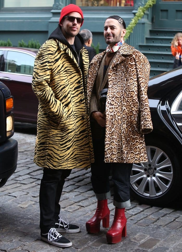 Fashion designer Marc Jacobs (R) is often seen in high heels when out with his husband Charly Defrancesco (L)