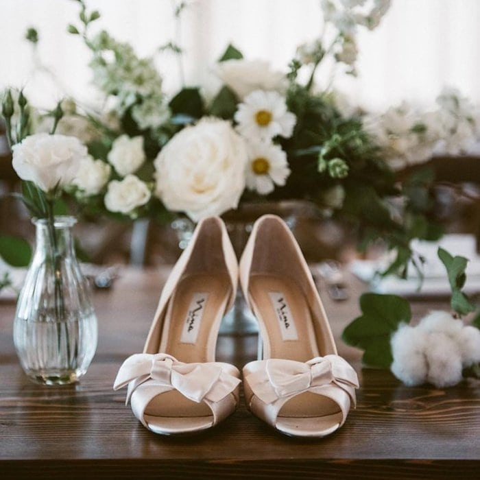 Founded in 1953, Nina Shoes is an American footwear design house known for evening handbags, bridal accessories, and jewelry