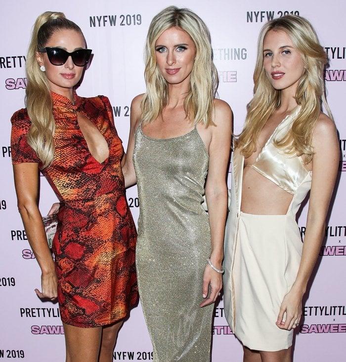 Paris Hilton, Nicky Hilton Rothschild, and Tessie Hilton arrive at PrettyLittleThing x Saweetie