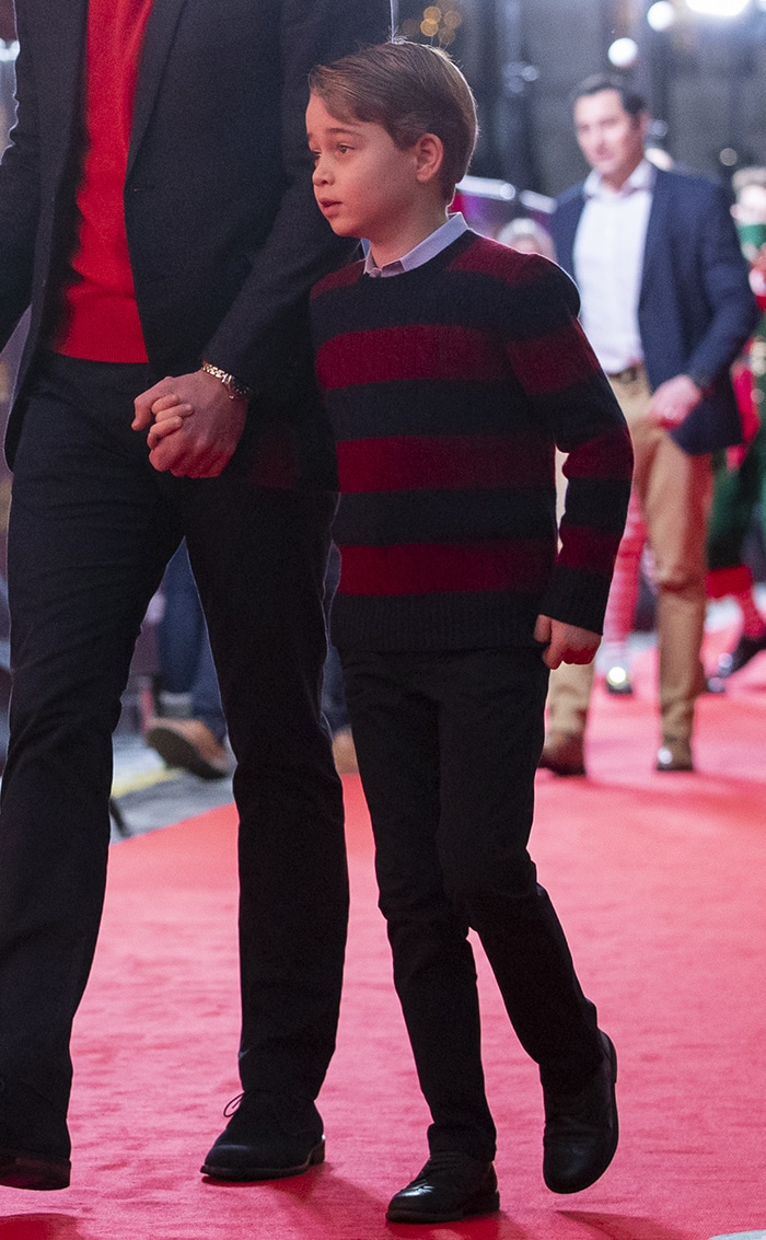Prince George wears a Ralph Laurent striped sweater with dark jeans and black shoes
