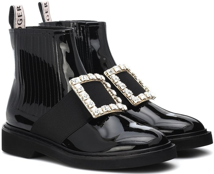 Roger Vivier reinvents the classic Chelsea boot silhouette by rendering it in glossy patent leather