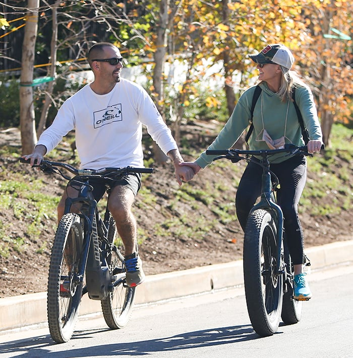 Clément Giraudet holds hands with wife Robin Wright while riding a bike in Los Angeles