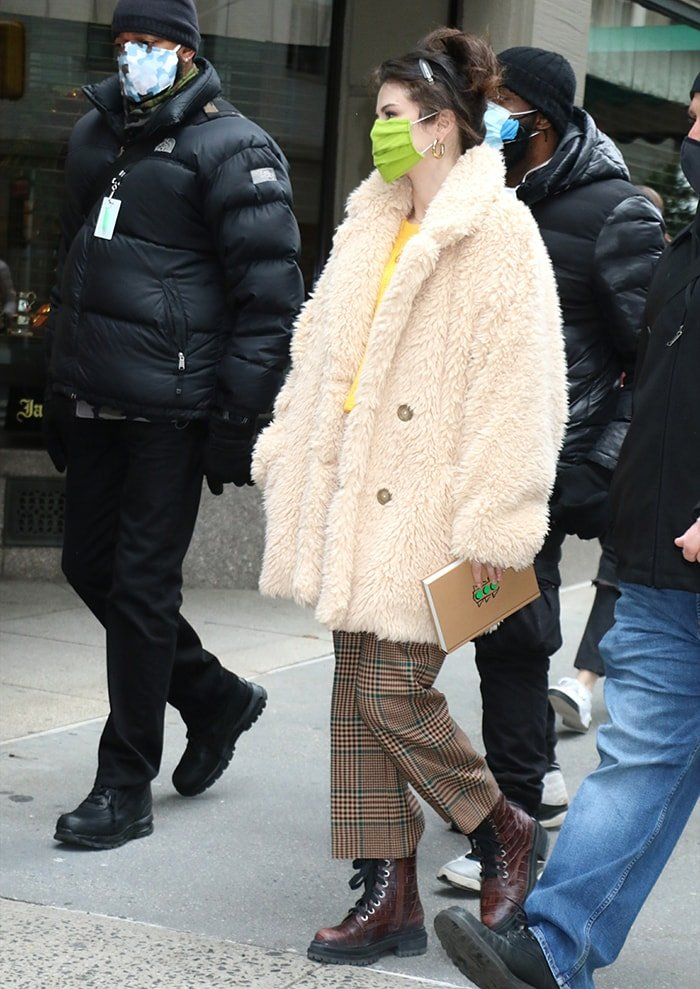 Selena Gomez wearing a Free People faux-fur coat with Veronica Beard plaid granda pants on the set of her Hulu series Only Murders in the Building on December 8, 2020