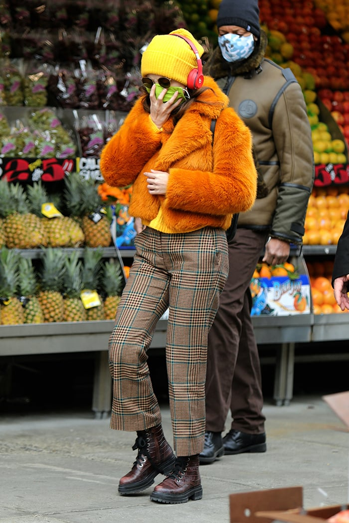 Selena Gomez in Michael Kors faux-fur burnt orange cropped jacket and plaid slacks on December 7, 2020