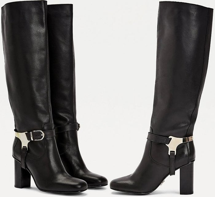 The silver-tone hardware and buckle design around the ankles give these long leather boots an equestrian chic aesthetic