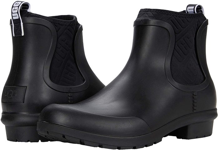 The UGG Chevonne slip-on ankle rain boot features a waterproof rubber upper that keeps up and keeps you looking cute