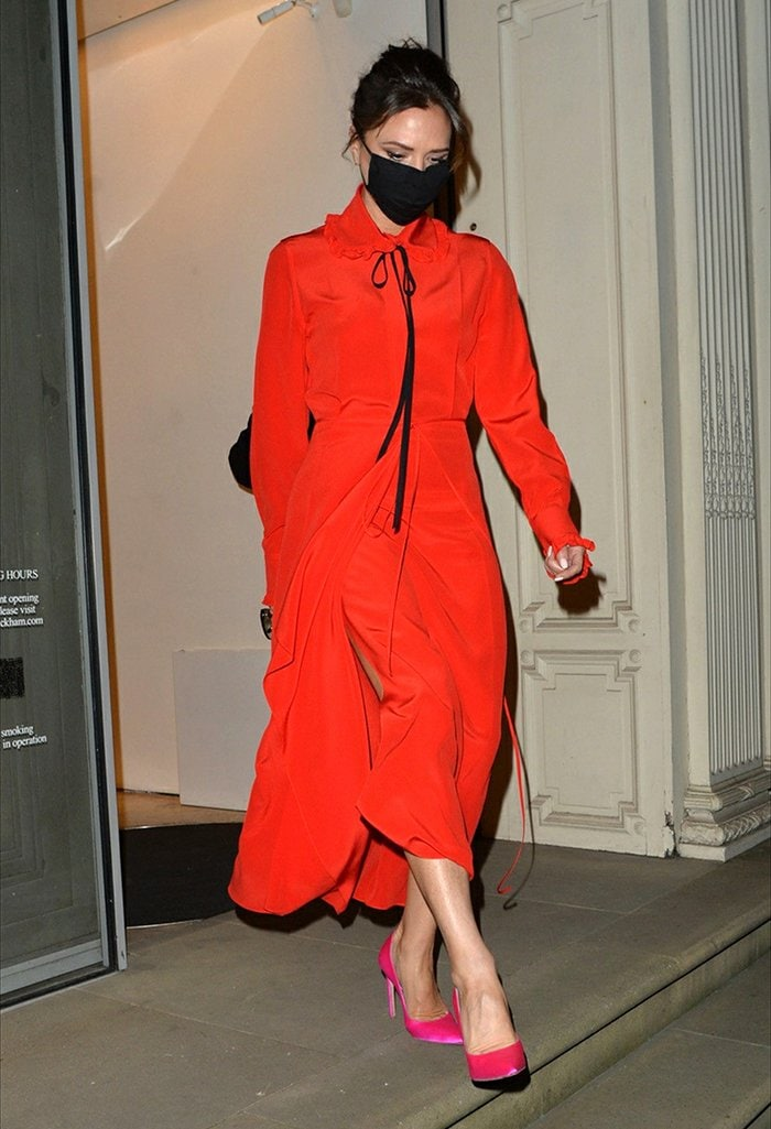 Victoria Beckham looks festive in her Victorian-inspired red midi frock