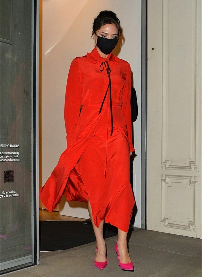 Victoria Beckham wears a flowy red dress from her pre-spring/summer 2021 collection