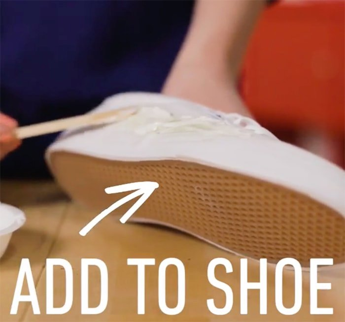 Add the paste to your shoes and start cleaning the grass stain