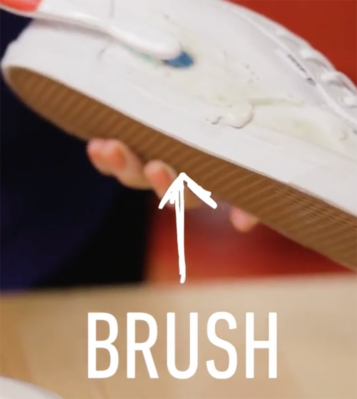 Use the toothbrush and gently brush off the grass stain