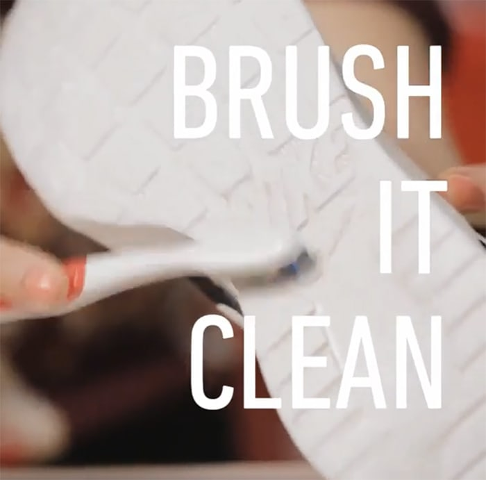 Scrub the wet rubber soles with a toothbrush
