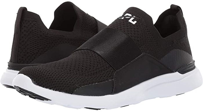 The slip-on Techloom Bliss running shoe features a milled satin elastic strap with raised embossed APL logo that allows for quick ingress and egress providing the ultimate comfort and a seamless fit