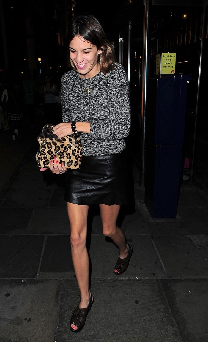 Alexa Chung parades her long legs in mini skirt and peep-toe shoes on September 2, 2010