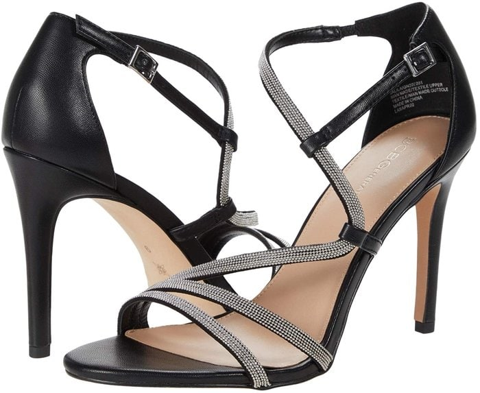 Rows of slender chains accent the straps and bring a subtle edge to a chic strappy sandal lofted by a tapered heel