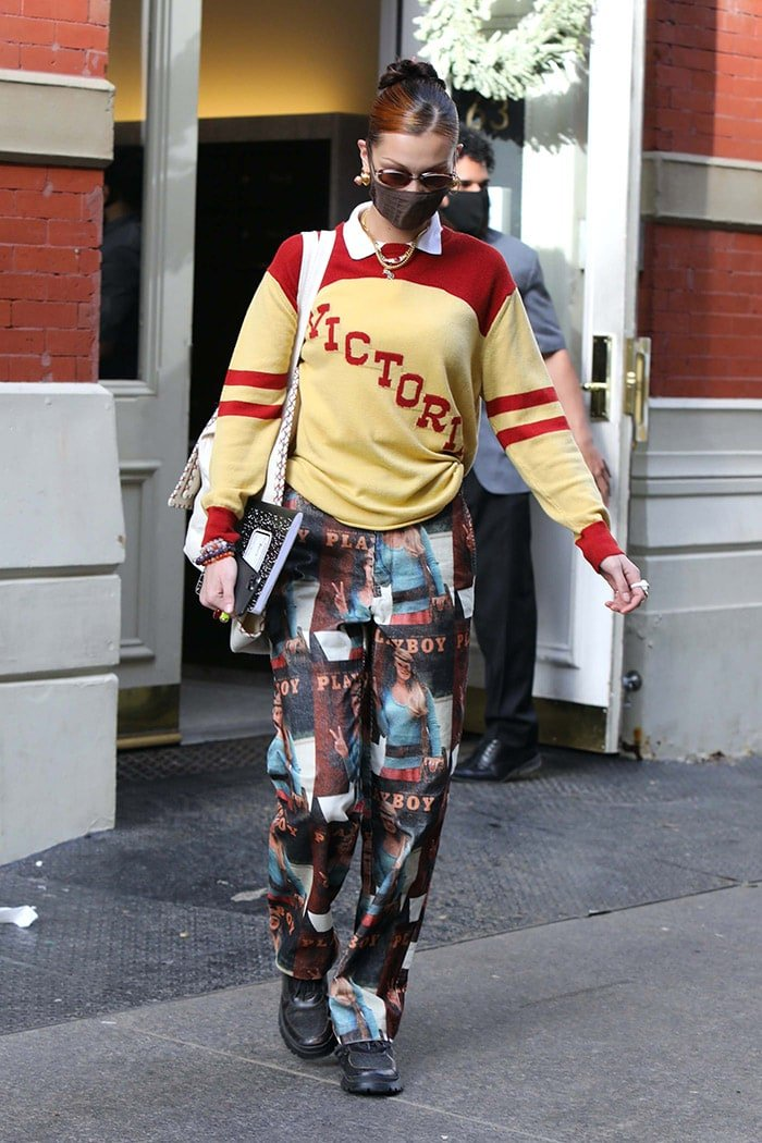 Bella Hadid goes for '90s collegiate look with Bode Victoria college sweater