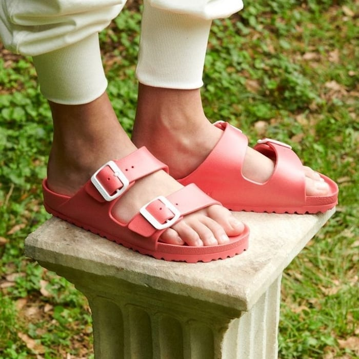 An iconic cushioned sandal is revised in a rubber-like texture with sleek adjustable straps designed to exercise foot and leg muscles while providing comfort
