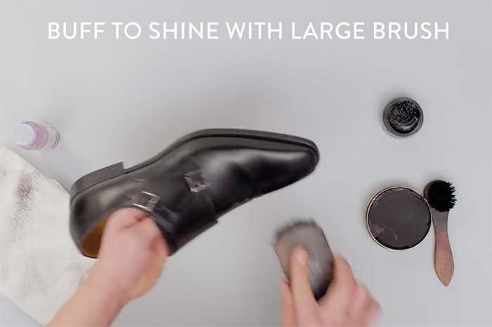 Buff the leather shoes using brisk, back-and-forth movements