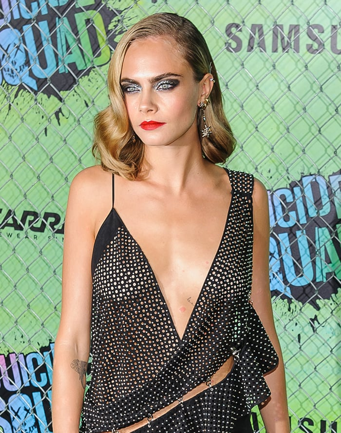 Braless Cara Delevingne flaunts her size 31B boobs at the Suicide Squad world premiere on August 2, 2016