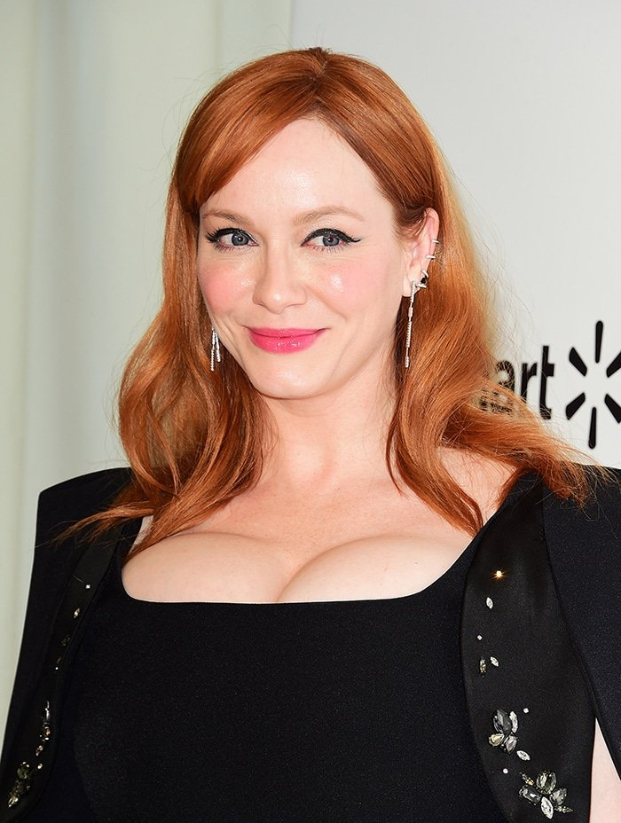 Christina Hendricks' 32F boobs spilling out of her black dress at Elton John Oscar Viewing Party on February 9, 2020