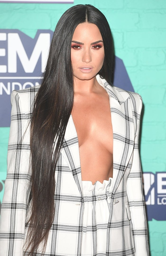 Demi Lovato wears nothing underneath her open blazer at the 2017 MTV Europe Music Awards on November 12, 2017