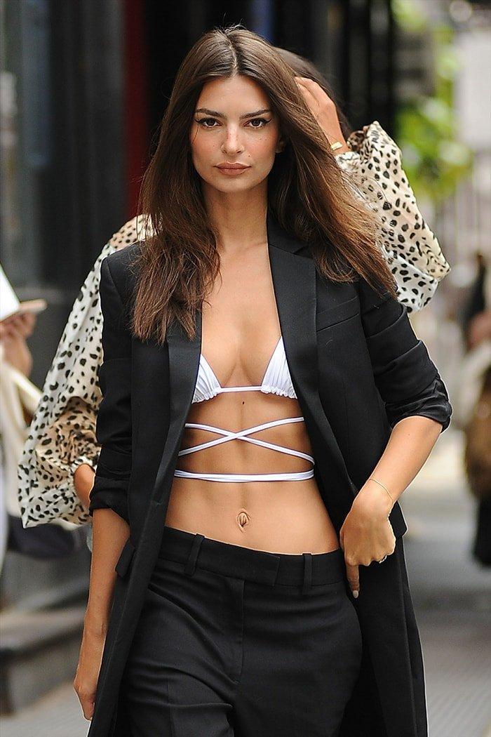 Emily Ratajkowski's asymmetrical round boobs in Inamorata bikini and pantsuit on September 5, 2019