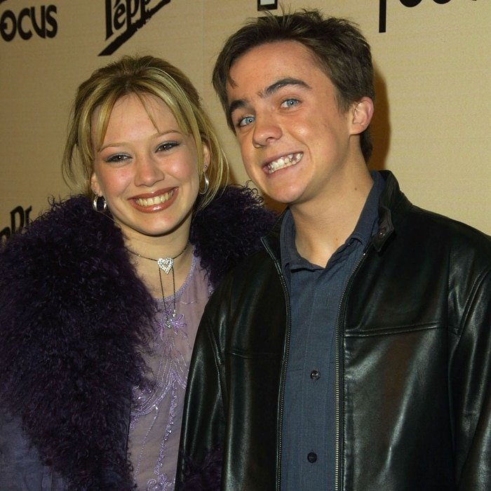 Frankie Muniz and his date Hilary Duff attend the Sizzlin 16 party held at Club A.D. in Hollywood